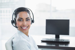 Content smiling agent wearing a headset Stock Photography