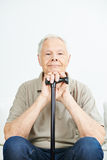 Content smiling old man with cane Royalty Free Stock Image