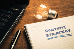 Content Strategy Plan. On notebook with glowing light bulb Stock Photo