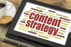 Content strategy word cloud. On a digital tablet with a cup of coffee Royalty Free Stock Photos