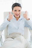 Content stylish brunette businesswoman giving thumbs up Stock Images