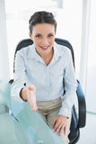 Content stylish brunette businesswoman presenting her hand Royalty Free Stock Photos