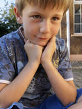 Content thoughtful young boy outdoors Royalty Free Stock Image