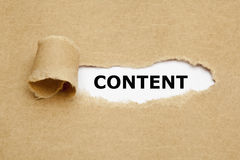 Content Torn Paper Concept. The word Content appearing behind torn brown paper stock photos