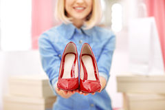 Content woman holding pair of  red shoes Stock Photos
