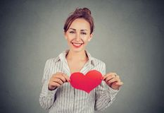 Content woman holding red heart on chest stock photos