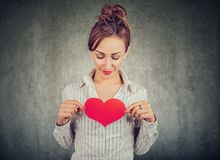 Content woman holding red heart on chest stock images