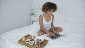 Content woman with laptop and breakfast stock footage