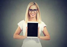 Content woman promoter showing tablet royalty free stock photos