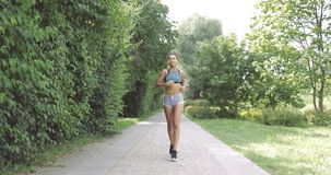 Content woman running in park stock footage