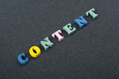 CONTENT word on black board background composed from colorful abc alphabet block wooden letters, copy space for ad text royalty free stock photography