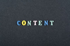 CONTENT word on black board background composed from colorful abc alphabet block wooden letters, copy space for ad text stock photography