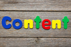 Content word. Made of colorful magnets royalty free stock photo
