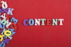 CONTENT word on red background composed from colorful abc alphabet block wooden letters, copy space for ad text stock images