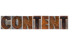 Content word typography in wood type Royalty Free Stock Image