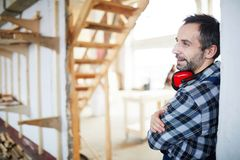 Content workman renovating house royalty free stock image