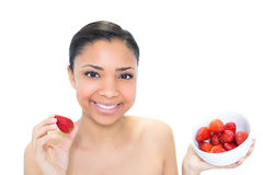 Content young dark haired model eating strawberries Royalty Free Stock Image