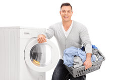 Content young man doing laundry Royalty Free Stock Photography