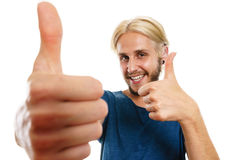 Content young man giving thumb up Royalty Free Stock Images