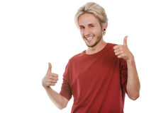 Content young man giving thumb up. Success concept. Young college student giving thumb up hand sign gesture, isolated on white Royalty Free Stock Photography
