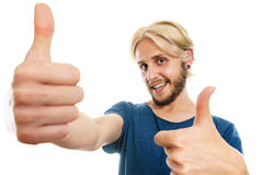 Content young man giving thumb up Stock Images