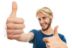 Content young man giving thumb up. Success concept. Young college student giving thumb up hand sign gesture, isolated on white Royalty Free Stock Photo