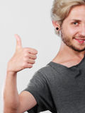 Content young man giving thumb up Royalty Free Stock Photography