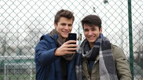 Content young men posing at camera for selfie royalty free stock images