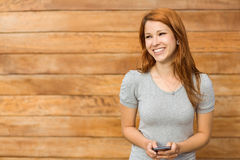 Content young woman dialing with her smartphone Stock Photos