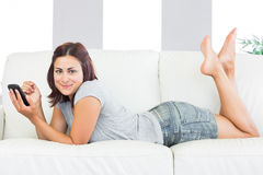 Content young woman lying on her couch at home Stock Photo