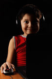 Contented boy in headphones with laptop Royalty Free Stock Photo