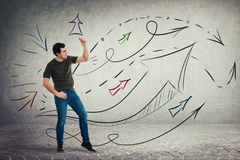 Contented casual young man dancing by the music. Moves feeling the rhythm, funny entertainer. Arrows and lines going up as body language expression stock photos