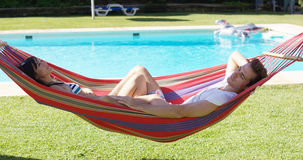 Contented couple relaxing in a hammock Royalty Free Stock Photo