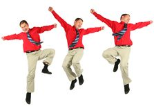 Contented dynamic jumping businessman in red shirt. Jumps on white royalty free stock images