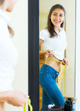 Contented girl admires her figure Royalty Free Stock Image