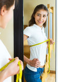 Contented girl admires her figure Stock Photography