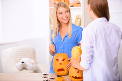 Contented girl craving the pumpkin Royalty Free Stock Photo