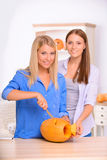 Contented girl craving the pumpkin Stock Image