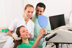 Contented patient in dental clinic Stock Image