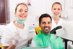 Contented patient at dentist office Royalty Free Stock Images