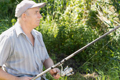 Contented senior fisherman Stock Photography