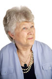 Contented Senior Lady. A pretty senior woman looking of with an expression of contentment. White background royalty free stock images