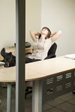 Contented woman in office Royalty Free Stock Photography