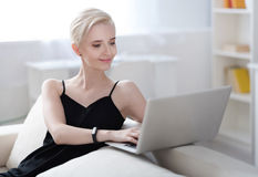 Contented woman working on laptop Stock Images