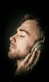 Contented young man listening to his music Royalty Free Stock Images