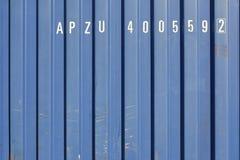 Contentor da carga com letras brancas aleatórias Fotos de Stock Royalty Free