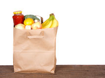 Contents of a brown paper shopping bag Royalty Free Stock Photos
