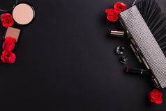 Contents of female handbag including jewellery and cosmetics Stock Photo