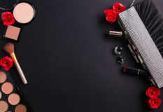 Contents of female handbag including jewellery and cosmetics Stock Photography
