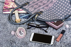 The contents of the female handbag Royalty Free Stock Image
